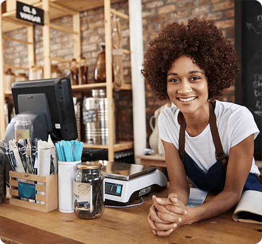 Small business owner at till